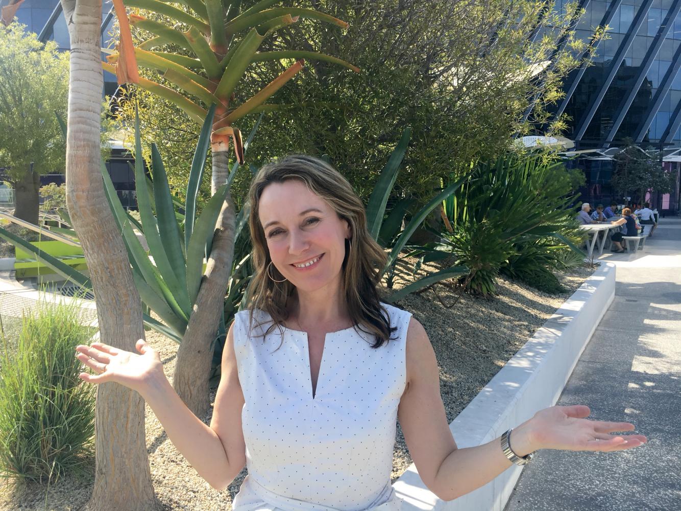 Dr Suellen Nicholson holds the #BalanceforBetter pose