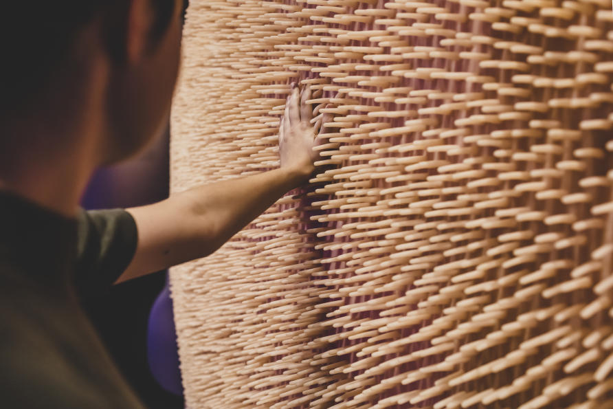A visitor at Melbourne Museum's 'Gut Feelings' exhibition with an installation representing the inside of the small intestine. Almost 1,500 exhibition visitors donated saliva for the microbiome mouth study. Picture: Rob Zugaro/Melbourne Museum.