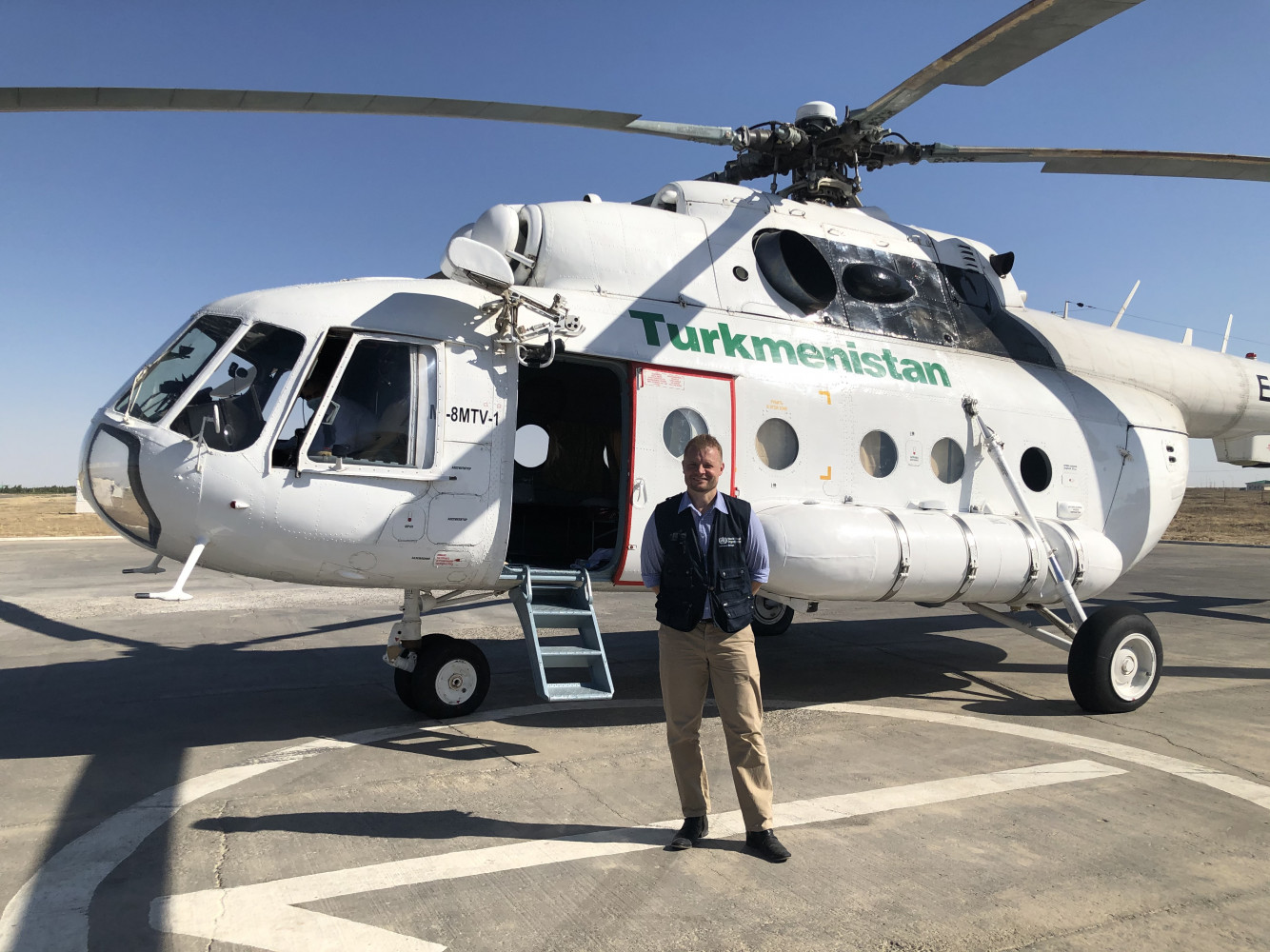 Dr Fielding in front of our helicopter transport to the Turkmenistan border crossing with Afghanistan.